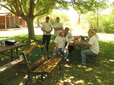The Lone Pine YCC Crew and freshly painted bench for the DeDecker Garden